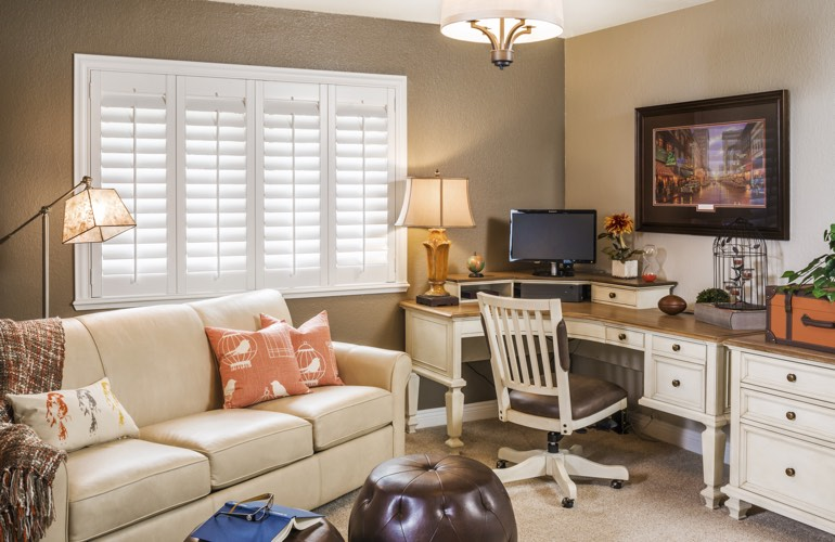 New York City home office with plantation window shutters.